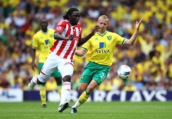 Stoke goalscorer Kenwyne Jones, left, and Norwich goalscorer Ritchie de Laet, right