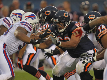 CHICAGO, IL - AUGUST 13: Roberto Garza #63 of the Chicago Bears blocks Dwan Edwards #98 of the Buffalo Bills during a preseason game at Soldier Field on August 13, 2011 in Chicago, Illinois. The Bears defeated the Bills 10-3. (Photo by Jonathan Daniel/Get