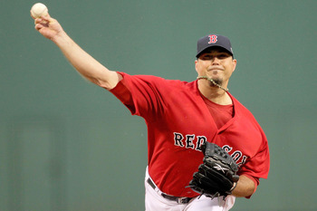 BOSTON, MA - JULY 8:  Josh Beckett #19 of the Boston Red Sox throws against the Baltimore Orioles in the first inning at Fenway Park on July 8, 2011 in Boston, Massachusetts.  (Photo by Jim Rogash/Getty Images)