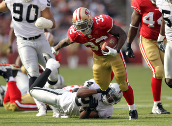 SAN FRANCISCO, CA - AUGUST 20:  Kendall Hunter #32 of the San Francisco 49ers avoids being tackled by Michael Huff #24 of the Oakland Raiders at Candlestick Park on August 20, 2011 in San Francisco, California.  (Photo by Ezra Shaw/Getty Images)