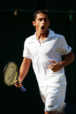 LONDON, ENGLAND - JUNE 25:  Nicolas Almagro of Spain reacts to a play during his third round match against  Mikhail Youzhny of Russia on Day Six of the Wimbledon Lawn Tennis Championships at the All England Lawn Tennis and Croquet Club on June 25, 2011 in
