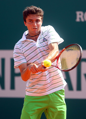 MONACO - APRIL 12:  Gilles Simon of France plays a backhand in his match against Thomaz Bellucci of Brazil during Day Three of the ATP Masters Series Tennis at the Monte Carlo Country Club on April 12, 2011 in Monte Carlo, Monaco.  (Photo by Julian Finney