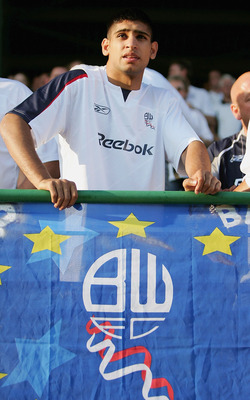 BOURGAS, BULGARIA - SEPTEMBER 29: Amir Khan, boxer and supporter of Bolton during the UEFA Cup 1st round second leg match between and Lokomotiv Plovdiv and Bolton Wanderers at the Naftex Stadium on September 29, 2005 in Bourgas, Bulgaria   (Photo by Micha