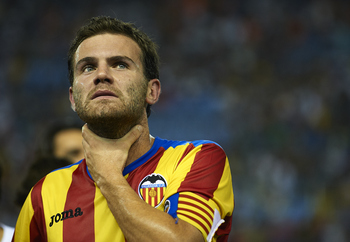 VALENCIA, SPAIN - AUGUST 12:  Juan Mata of Valencia looks on after the Orange Trophy match between Valencia and Roma at Estadio Mestalla on August 12, 2011 in Valencia, Spain.  (Photo by Manuel Queimadelos Alonso/Getty Images)