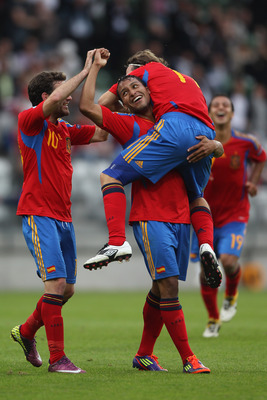 VIBORG, DENMARK - JUNE 22:  Jeffren Suarez (C) of Spain celebrates scoring the third goal with Diego Capel (R) and Juan Mata (L) during the UEFA European Under-21 Championship semi-final match between Belarus and Spain at the Viborg Stadium on June 22, 20