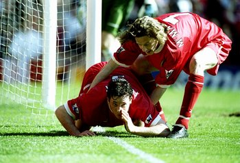 3 Apr 1999:  Robbie Fowler of Liverpool is pulled away by team mate Steve McManaman after mimicking cocaine snorting to celebrate his first goal against Everton in the FA Carling Premiership match at Anfield in Liverpool, England. Liverpool won 3-2. \ Man