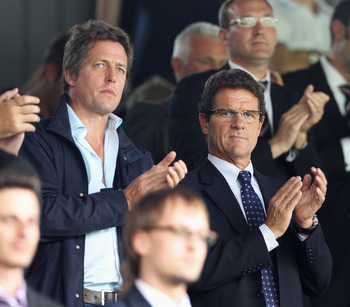 LONDON, ENGLAND - AUGUST 22:  England manager Fabio Capello and actor Hugh Grant (L) look on prior to the Barclays Premier League match between Fulham and Manchester United at Craven Cottage on August 22, 2010 in London, England.  (Photo by Phil Cole/Gett