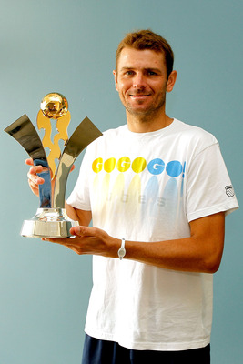 MASON, OH - AUGUST 19:  Mardy Fish poses with the US Open Series trophy after securing the title win his with win over Rafael Nadal during the Western & Southern Open at the Lindner Family Tennis Center on August 19, 2011 in Mason, Ohio.  (Photo by Matthe