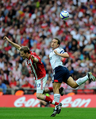Kevin Davies battles Sunderland bad boy Ryan shawcross