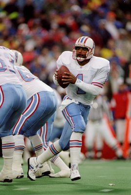 3 Jan 1993:  Quarterback Warren Moon of the Houston Oilers scrambles with the ball during a game against the Buffalo Bills at Rich Stadium in Orchard Park, New York.  The Bills won the game 41-38. Mandatory Credit: Rick Stewart  /Allsport