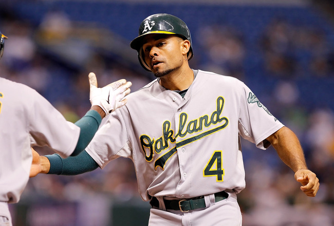 ST. PETERSBURG, FL - AUGUST 05:  Outfielder Coco Crisp #4 of the Oakland Athletics is congratulated by Jemile Weeks #19 after his sixth inning home run against the Tampa Bay Rays during the game at Tropicana Field on August 5, 2011 in St. Petersburg, Flor