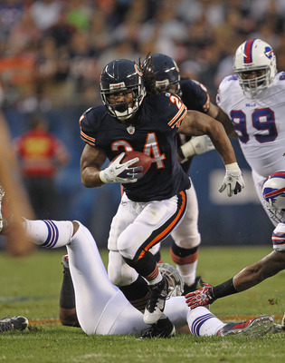 CHICAGO, IL - AUGUST 13:  Marion Barber #24 of the Chicago Bears runs for yardage against the Buffalo Bills close in during a preseason game at Soldier Field on August 13, 2011 in Chicago, Illinois.  (Photo by Jonathan Daniel/Getty Images)