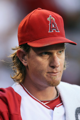 ANAHEIM, CA - AUGUST 18:  Jered Weaver #36 of the Los Angeles Angels of Anaheim looks on from the dugout against the Texas Rangers at Angel Stadium of Anaheim on August 18, 2011 in Anaheim, California.  (Photo by Jeff Gross/Getty Images)