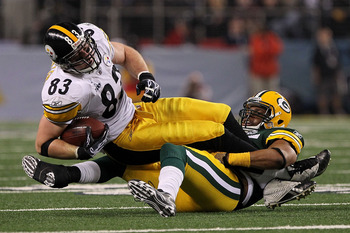 ARLINGTON, TX - FEBRUARY 06:  Heath Miller #83 of the Pittsburgh Steelers is tackled by Desmond Bishop #55 of the Green Bay Packers during Super Bowl XLV at Cowboys Stadium on February 6, 2011 in Arlington, Texas.  (Photo by Doug Pensinger/Getty Images)