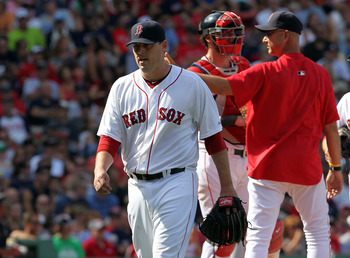 BOSTON - AUGUST 17:  John Lackey #41 of the Boston Red Sox leaves the game in the seventh inning against the Tampa Bay Rays at Fenway Park on August 17, 2011 in Boston, Massachusetts.  (Photo by Jim Rogash/Getty Images)