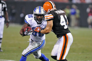 CLEVELAND, OH - AUGUST 19: Jerome Harrison #36 of the Detroit Lions rushes for a first down against Raymond Ventrone #41 of the Cleveland Browns during the third quarter at Cleveland Browns Stadium on August 19, 2011 in Cleveland, Ohio. The Tigers defeate
