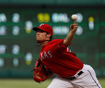 ARLINGTON, TX - AUGUST 22: C.J. Wilson #36 of the Texas Rangers pitches against the Boston Red Sox at Rangers Ballpark in Arlington on August 22, 2011 in Arlington, Texas.  (Photo by Tom Pennington/Getty Images)
