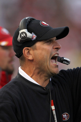 SAN FRANCISCO, CA - AUGUST 20:  Head coach Jim Harbaugh of the San Francisco 49ers shouts to his team during their game against the Oakland Raiders at Candlestick Park on August 20, 2011 in San Francisco, California.  (Photo by Ezra Shaw/Getty Images)