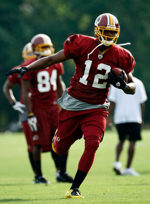 ASHBURN, VA - JULY 30:  Washington Redskins wide receiver Malcom Kelly (#12) catches a pass during drills on opening day of training camp July 30, 2009 in Ashburn, Virginia.  (Photo by Win McNamee/Getty Images)