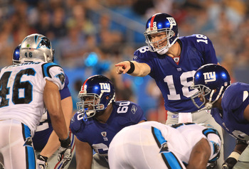 CHARLOTTE, NC - AUGUST 13:  Sage Rosenfels #18 of the New York Giants against the Carolina Panthers during their preseason game at Bank of America Stadium on August 13, 2011 in Charlotte, North Carolina.  (Photo by Streeter Lecka/Getty Images)