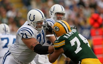 GREEN BAY, WI - OCTOBER 19:  Tackle Ryan Diem #71 of the Indianapolis Colts blocks against Aaron kampman #74 of the Green Bay Packers on October 19, 2008 at Lambeau Field in Green Bay Wisconsin. The Packers won 34-14.   (Photo by Stephen Dunn/Getty Images