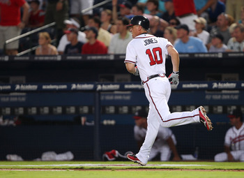ATLANTA, GA - AUGUST 12:  Third baseman Chipper Jones #10 of the Atlanta Braves rounds the bases after hitting a home run during the game against the Chicago Cubs at Turner Field on August 12, 2011 in Atlanta, Georgia.  (Photo by Mike Zarrilli/Getty Image