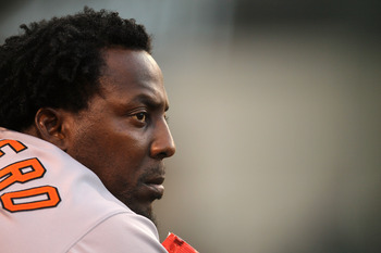 ANAHEIM, CA - AUGUST 20:  Vladimir Guerrero #27 of the Baltimore Orioles looks on from the dugout during the game with the Los Angeles Angels of Anaheim on August 20, 2011 at Angel Stadium in Anaheim, California.  (Photo by Stephen Dunn/Getty Images)