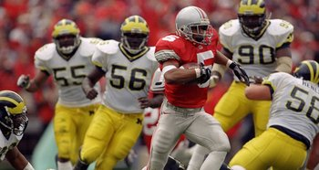 21 Nov 1998: Michael Wiley #5 of the Ohio State Buckeyes grips the ball as he makes a touchdown run during the game against the Michigan Wolverines at Ohio Stadium in Columbus, Ohio. Ohio State defeated Michigan 31-16. Mandatory Credit: Harry How  /Allspo