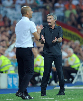 MADRID, SPAIN - AUGUST 14:  Real Madrid head coach Jose Mourinho  (L)applauds beside Barcelona head coach Josep Guardiola during the Super Cup first leg match between Real Madrid and Barcelona at Estadio Santiago Bernabeu on August 14, 2011 in Madrid, Spa