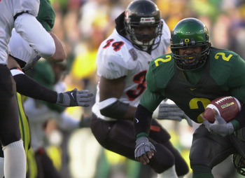 EUGENE, OR - DECEMBER 1:  Tailback Onterrio Smith #2 of Oregon Ducks fights for a few more yards against the Oregon State Beavers at Autzen Stadium in Eugene Oregon on December 1, 2001.  Oregon defeated Oregon State 17-14.  (Photo by Otto Greule/Getty Ima