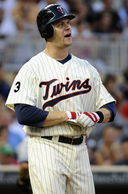 MINNEAPOLIS, MN - AUGUST 18: Justin Morneau #33 of the Minnesota Twins reacts to striking out after having a home run reversed by the umpires during the first inning of the game against the New York Yankees on August 18, 2011 at Target Field in Minneapoli