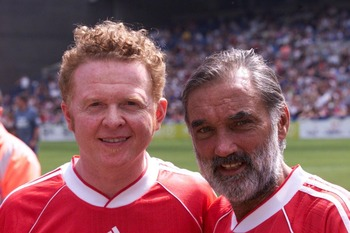 LONDON - MAY 28:  British singer Mick Hucknell (L), frontman with 'Simply Red', poses with Manchester United soccer legend George Best (R) during the Music Industry Soccer Six tournament held at Stamford Bridge, Chelsea FC, London on May 28, 2001. The ann