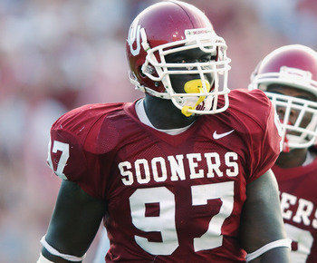 DALLAS - OCTOBER 12:  Defensive lineman Tommie Harris #97 of the Oklahoma Sooners stands on the field during the Red River Shootout against the Texas Longhorns at the Cotton Bowl on October 12, 2002 in Dallas, Texas.  Oklahoma won 35-24.  (Photo by Harry