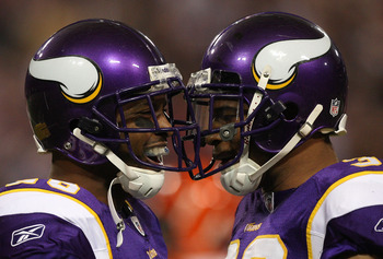 MINNEAPOLIS, MN - DECEMBER 13:  Antoine Winfield #26 (L) and Jamarca Sanford #33 of the Minnesota Vikings celebrate a play against the Cincinnati Bengals on December 13, 2009 at Hubert H. Humphrey Metrodome in Minneapolis, Minnesota. (Photo by Elsa/Getty