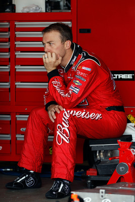 WATKINS GLEN, NY - AUGUST 12:  Kevin Harvick, driver of the #29 Budweiser Chevrolet, sits in the garage area during practice for the NASCAR Sprint Cup Series Heluva Good! Sour Cream Dips at the Glen at Watkins Glen International on August 12, 2011 in Watk