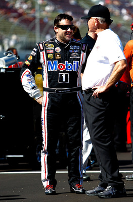 BROOKLYN, MI - AUGUST 19:  Tony Stewart (L), driver of the #14 Mobil 1/Office Depot Chevrolet, stands with Joe Gibbs (R) during qualifying for the NASCAR Sprint Cup Series Pure Michigan 400 at Michigan International Speedway on August 19, 2011 in Brooklyn