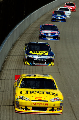 BROOKLYN, MI - AUGUST 21: Clint Bowyer, driver of the #33 Cheerios/Hamburger Helper Chevrolet, leads a group of cars during the NASCAR Sprint Cup Series Pure Michigan 400 at Michigan International Speedway on August 21, 2011 in Brooklyn, Michigan.  (Photo
