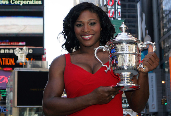 NEW YORK - SEPTEMBER 08:  2008 U.S. Open tennis champion Serena Williams poses with her trophy in Times Square on September 8, 2008 in New York City.  (Photo by Mike Stobe/Getty Images)