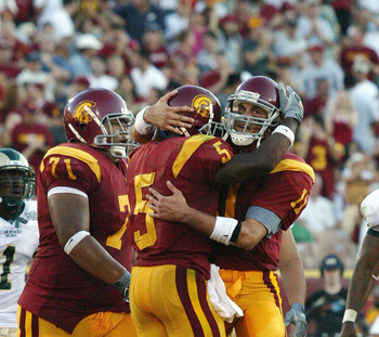 LOS ANGELES - SEPTEMBER 11:  Tail back Reggie Bush #5 and quarterback Matt Leinart #11 of the University of Southern California Trojans celebrate during a NCAA game against the Colorado State University Rams at the Los Angeles Memorial Coliseum on Septemb