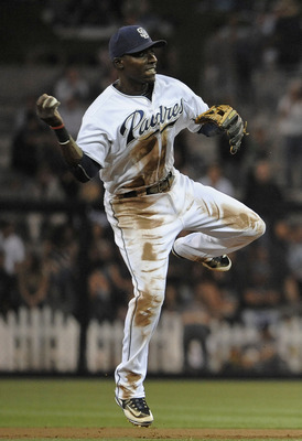 SAN DIEGO, CA - AUGUST 18:  Orlando Hudson #1 of the San Diego Padres can't turn a double play after getting the force out on Gaby Sanchez #15 of the Florida Marlins during the second inning of a baseball game the at Petco Park on August 18, 2011 in San D