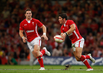 CARDIFF, WALES - AUGUST 20: James Hook of Wales passes the ball watched by teammates George North during the rugby union international friendly match between Wales and Argentina at the Millennium Stadium on August 20, 2011 in Cardiff, Wales.  (Photo by Ha