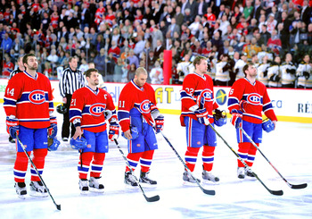 MONTREAL, CANADA - APRIL 26:  The Montreal Canadiens stand at attention during the National Anthems before Game Six of the Eastern Conference Quarterfinals against the Boston Bruins during the 2011 NHL Stanley Cup Playoffs at the Bell Centre on April 26,