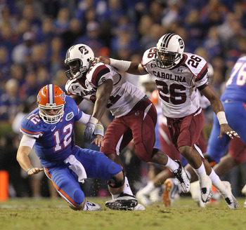GAINESVILLE, FL - NOVEMBER 13:  Josh Dickerson #41 and Antonio Allen #26 of the South Carolina Gamecocks knock down quarterback John Brantley #12 of the Florida Gators during a game at Ben Hill Griffin Stadium on November 13, 2010 in Gainesville, Florida.