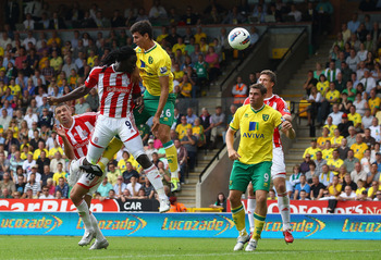 NORWICH, ENGLAND - AUGUST 21:  Kenwyne Jones of Stoke heads the equalising goal in the last minute during the Barclay's premier league match between Norwich and Stoke City at Carrow Road on August 21, 2011 in Norwich, England.  (Photo by Julian Finney/Get