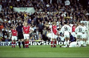 11 May 1999:  Emmanuel Petit of Arsenal recieves a yellow card for a foul during the FA Carling Premiership match against Leeds United played at Elland Road in Leeds, England.  The match finished in a 1-0 victory for Leeds United and the result dealt a se