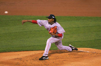 ST LOUIS - OCTOBER 26:  Pitcher Pedro Martinez #45 of the Boston Red Sox throws a pitch against the St. Louis Cardinals in the first inning during game three of the World Series on October 26, 2004 at Busch Stadium in St. Louis, Missouri. (Photo by Ezra S
