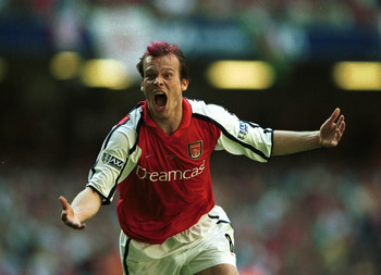 12 May 2001:  Fredrik Ljungberg celebrates after scoring the opening goal for Arsenal during the AXA sponsored 2001 FA Cup Final between Arsenal v Liverpool at the Millennium Stadium, Cardiff. Mandatory Credit: Clive Brunskill/ALLSPORT