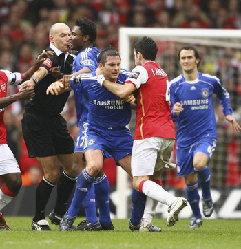 CARDIFF, UNITED KINGDOM - FEBRUARY 25:  Referee Howard Webb attempts to split up a brawl between the Arsenal and Chelsea players during the Carling Cup Final match between Chelsea and Arsenal at the Millennium Stadium on February 25, 2007 in Cardiff, Wale