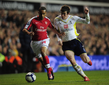 LONDON, ENGLAND - APRIL 14:  Theo Walcott of Arsenal is challenged by Gareth Bale of Tottenham Hotspur during the Barclays Premier League match between Tottenham Hotspur and Arsenal at White Hart Lane on April 14, 2010 in London, England.  (Photo by Shaun
