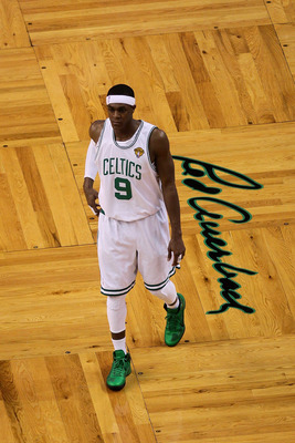 BOSTON - JUNE 08:  Rajon Rondo #9 of the Boston Celtics walks past a logo of Red Auerbach's signature in Game Three of the 2010 NBA Finals against the Los Angeles Lakers on June 8, 2010 at TD Garden in Boston, Massachusetts. NOTE TO USER: User expressly a